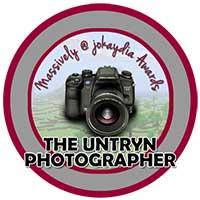 00!. Untryn Photographer Award Icon